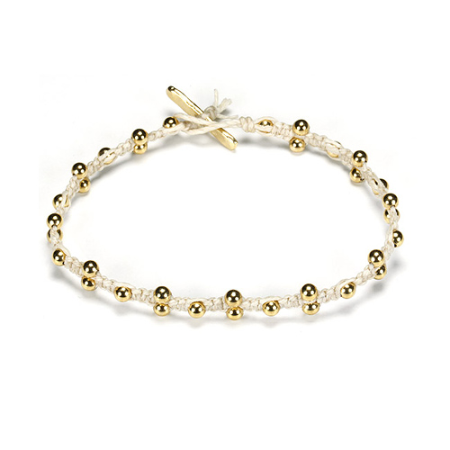 sparkle macrame bracelet with scattered brass beads on ivory irish linen