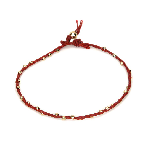 sparkle twisted strand gold dipped bracelet on red irish linen