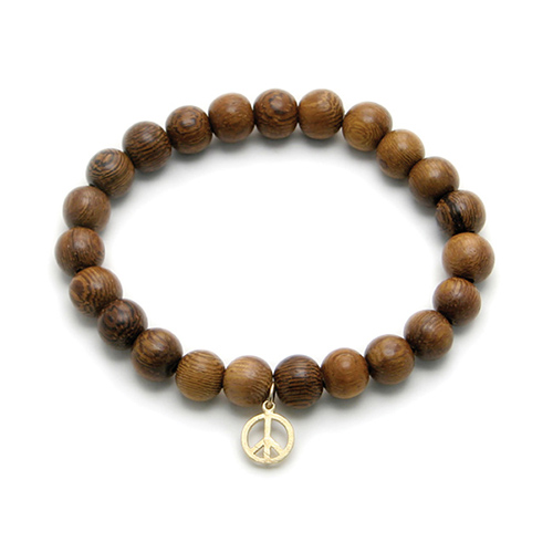 wood bracelet in teak with gold dipped peace sign