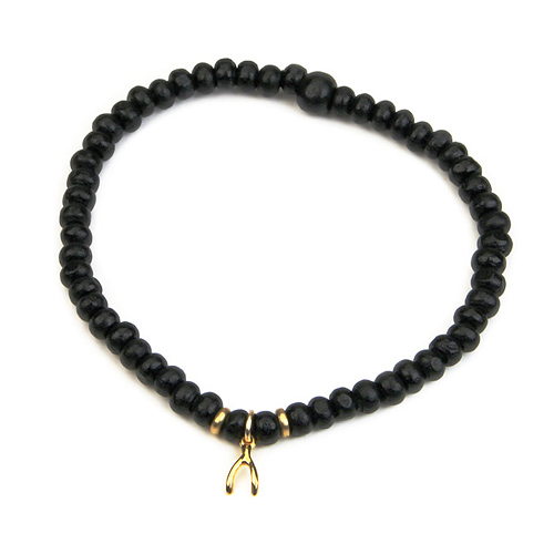 not to worry teeny tiny ebony wood bracelet with gold dipped wishbone