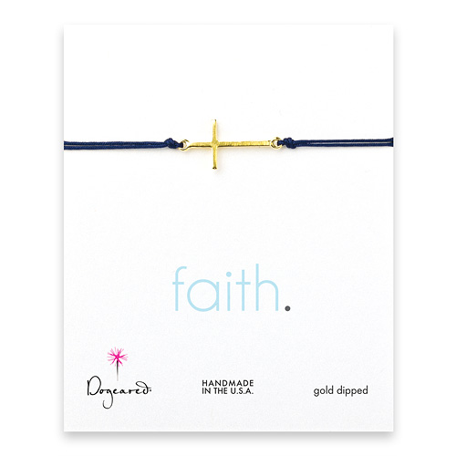 sideways cross bracelet on navy cord, gold dipped