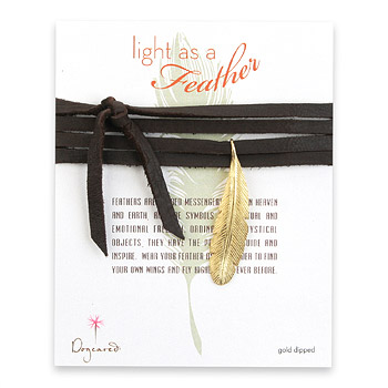 light as a feather large gold dipped feather necklace on leather