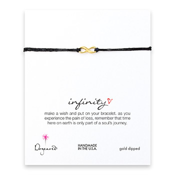 infinity gold dipped bracelet on black irish linen