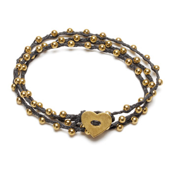 sparkle wrap bracelet with gold dipped heart closure on black irish linen