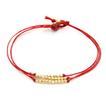 sparkle bracelet on red irish linen, gold dipped