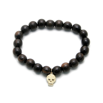wood bracelet in ebony with gold dipped skull