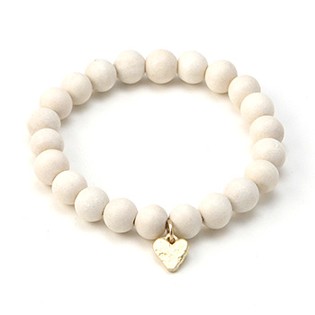 wood bracelet in ivory with gold dipped mini stone heart