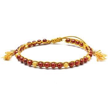red jasper healing gem bracelet with gold dipped stardust beads and tassel