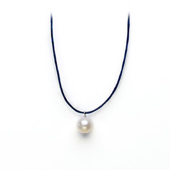 white pearl on navy waxed cotton, sterling silver toggle closure