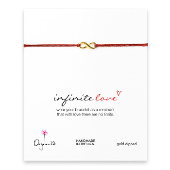 small infinite love bracelet on red irish linen, gold dipped