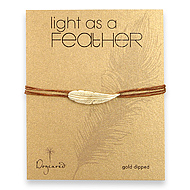 light as a feather medium gold dipped feather bracelet on tobacco irish linen