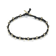 sparkle macrame bracelet with scattered brass beads on black irish linen