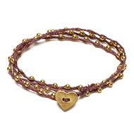 sparkle wrap bracelet with gold dipped heart closure on maroon irish linen