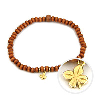 not to worry teeny tiny rust wood bracelet with gold dipped four leaf clover