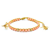 pink coral healing gem bracelet with gold dipped stardust beads and tassel